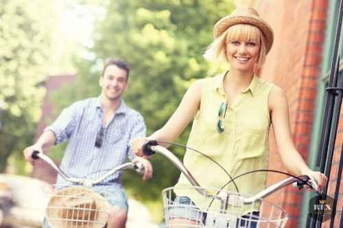 Young couple cycling together in the city